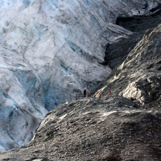 "A woman stands at the end of Exit Glacier's ""Edge of the Glacier"" trail."