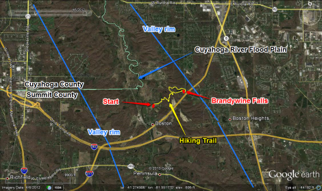 Aerial map of Brandywine Falls region. Graphics show the path of the hiking trail (yellow), the location of Brandywine Falls (red), as well as general constraints for the western and eastern edges of the Cuyahoga Valley (blue).
