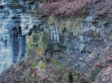 "The fissile Bedford Shale helps to create the ""wedding vale"" effect for the falls.  A large block of Berea Sandstone lays here as a result of undercutting.  Notice the frost-wedging action!!"